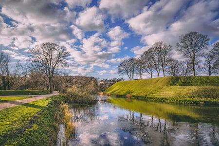 Green park and lake near the Kastellet fortress. Copenhagen, Denmark