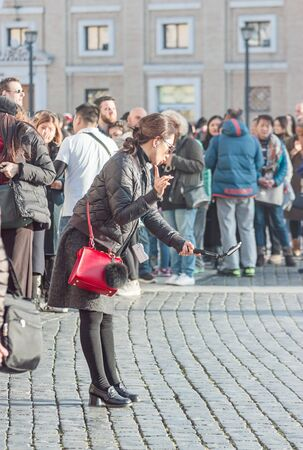 Vatican, 21 January, 2017. Young women makes selfie on the square Editorial