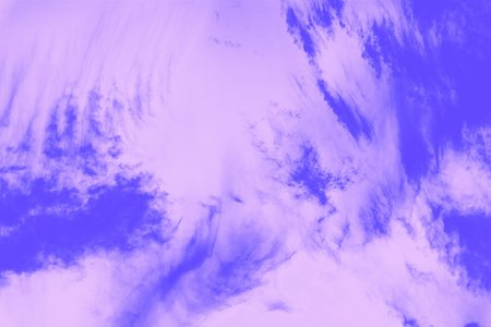Violet purple sky with cirro cumulus clouds. Sky background. Looks like a marble texture Reklamní fotografie