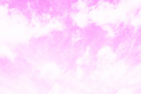 Pink sky with fluffy white clouds. Fantasy sky background