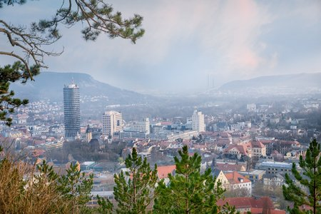 Beautiful panoramic view of hills, old town and tower. Jena, Germany