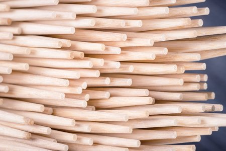 A lot of bamboo sushi sticks or chopsticks. Bamboo background.