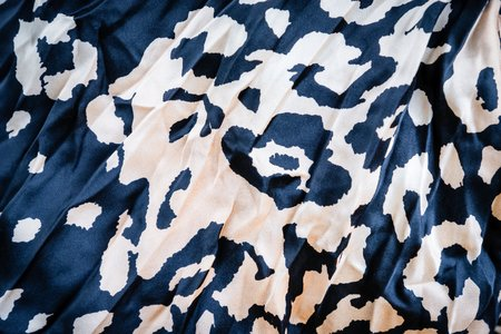 Black and color beige background with leopard print. Trendy leopard pattern 2019