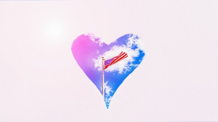 American flag on the blue sky background in heart. Pastel background, copy space. 16:9 panoramic format