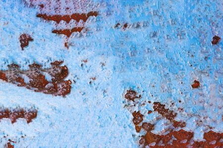 Rusty metal surface with blue paint flaking. Old cracked paint pattern, cracking texture. Copy space Stock Photo