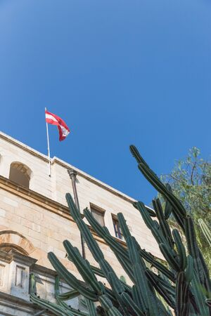 Austrian Hospice in Jerusalem, Israel. Austrian flag and blue sky, details, copy space