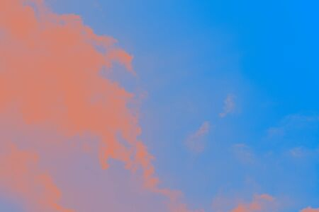 Beautiful blue sky with unreal bright orange clouds. Abstract fantasy background 免版税图像