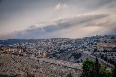 Beautiful view of jewish cemetery and Jerusalem Old City from the Mount of Olives. Israel. Evening soft light