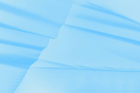 Pale light blue gradient background with paper waves