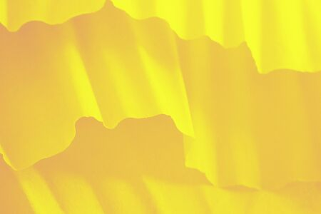 Vivid yellow gradient background with paper waves