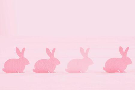 Pink coral gradient Easter bunny on a light pink background Standard-Bild