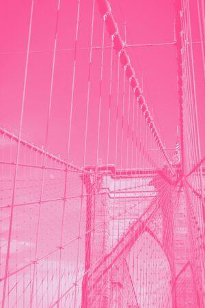 Brooklyn bridge in New York city, USA, details. Pink gradient photo