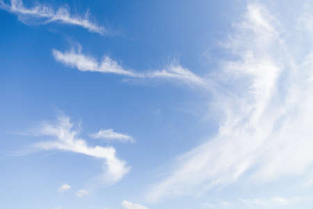 Light blue sky with blurred white clouds, sky background