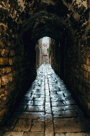 Dark narrow street in old town. Split Croatia