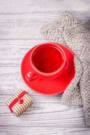 Red cup of tea and a gift for Valentines Day with red heart