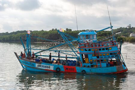 Krabi Province, Thailand - January 01, 2018: Fishing boat on the river. A typical fishing boat of Thailand with fishermen on board. Blue color of the case.