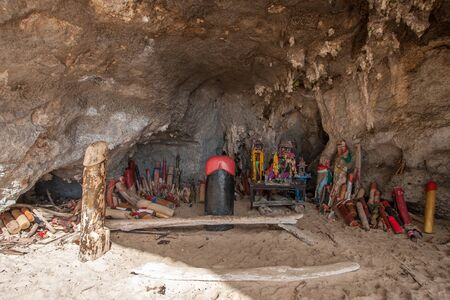 Many wooden penises in the cave of the Princess. A symbol of sexual strength and fertility. Generative energy of a lingam. Adoration of the Phallus.