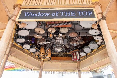 Georgetown, Malaysia - January 11, 2018: Window of the top - Inverted musical instruments on the roof of a skyscraper in Georgetown on the island of Penang. Drums and cymbals, keyboards and accordion