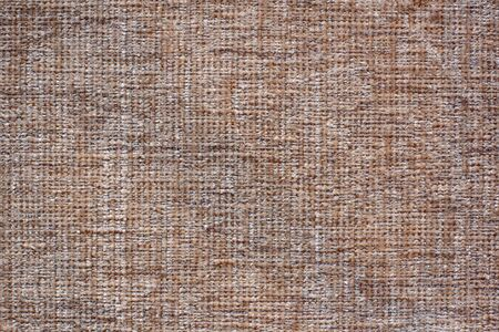Color fabric texture. Soft brown fabric with woolen threads. Copy space