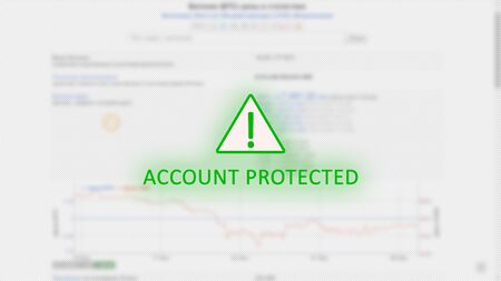 Account protected concept with an exclamation mark in a green triangle on a light background of blurry bitcoin graphics. Security of personal data.