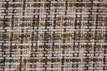 The texture of the fabric. Cross weaving with fleecy brown and white threads. Copy space. 写真素材