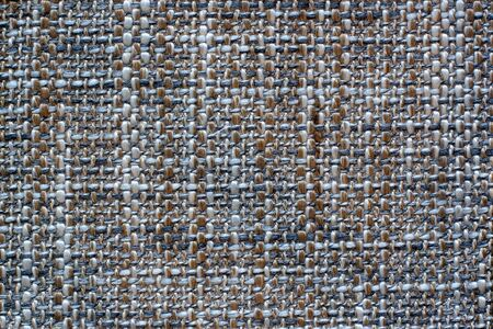 Soft fabric texture. Cross weaving. Fleecy black, brown and white threads. Copy space.