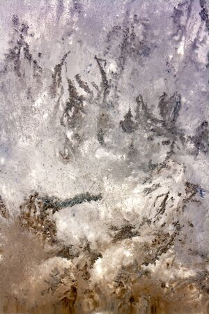 Abstract background texture and structure of melted Baikal ice. Ice with bubbles and cracks. Amazing winter pattern. Vertical. Stok Fotoğraf
