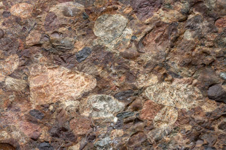 Geological section of rocky slab consisting of different stones. Horizontal image. Standard-Bild