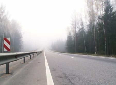 uninhabited: Uninhabited highway on background with mist