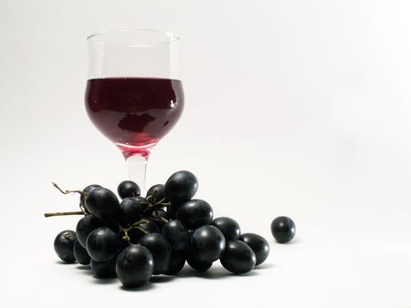 bocal: Bocal of red wine and bunch of grapes on white background