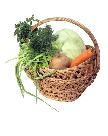 molly: Different fresh vegetables in wooden wicker molly Stock Photo