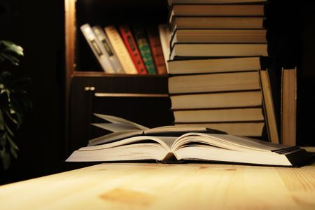 Various books on wooden table on background with evening home interior Stock Photo - 2625302