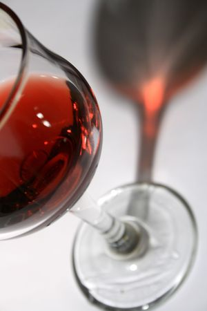 Close-up at goblet of red wine with long dark shadow on gray background Stock Photo - 2732688