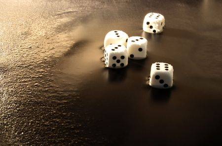 fervour: Close-up of five white dice lying on dark water background Stock Photo