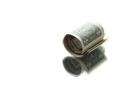 reverberation: Little roll of one dollar banknotes with reverberation on white background