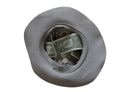 on the dole: Beggars hat with money lying on white background Stock Photo