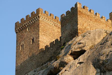 embrasure: Ancient fortress on the rock on blue sky background