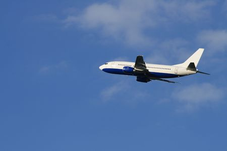 pilotage: Modern passenger plane flying in blue sky with clouds Stock Photo