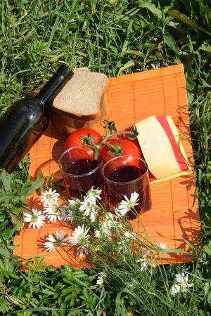 nice food: Nice food and red wine with flowers on green grass Фото со стока