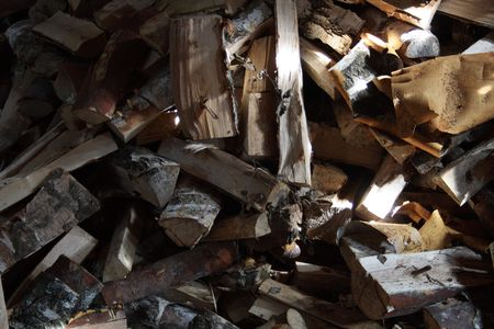 woodshed: Background with firewood lying in woodshed