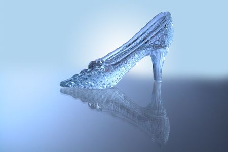 Nice glass slipper with reverberation standing on blue background