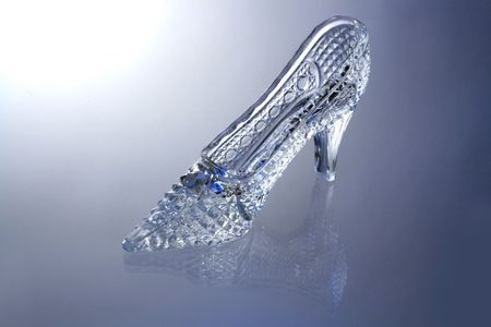 cinderella shoes: Nice glass slipper with reverberation standing on gray background