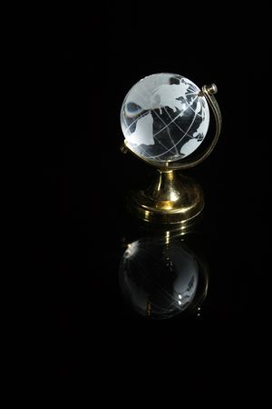 reverberation: Little glassy globe with reverberation standing on dark background