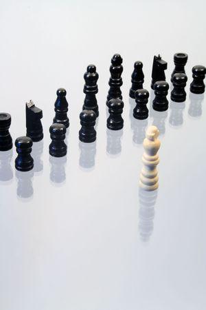 chessmen: Various chessmen standing on glassy background with reverberation