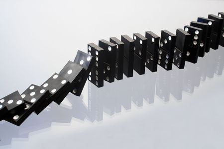 reverberation: Black dominoes dice with reverberation standing on gray glassy background