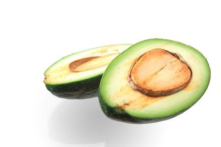 reverberation: Isolated fresh slit avocado with reverberation lying on white background Stock Photo