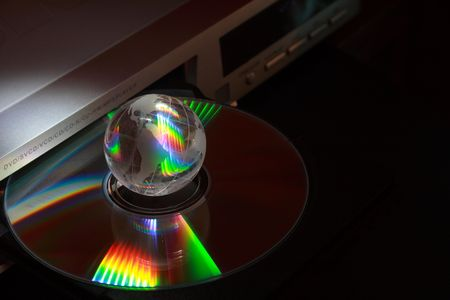 diskdrive: Opened disk drive with little glassy globe on dark background