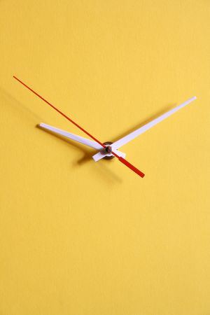 papery: Yellow papery clock dial with moving second hand Stock Photo