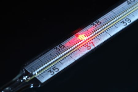 celcius: Celcius thermometer with red fire point near thirty seven numeral Stock Photo