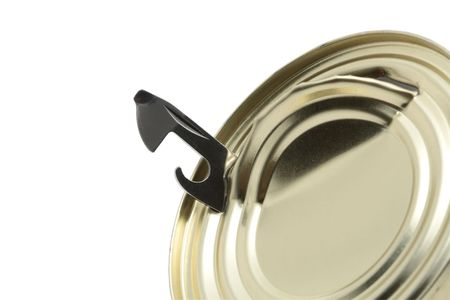 can opener: Close-up of can opener inside tin isolated on white background